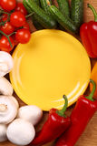Empty plate and vegetables Stock Image