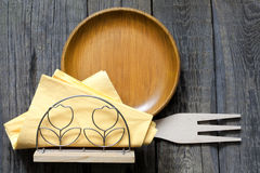 Empty plate on vintage boards with cutlery Royalty Free Stock Image