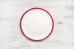 Empty plate on vintage wooden texture. Top view with copyspace royalty free stock photography