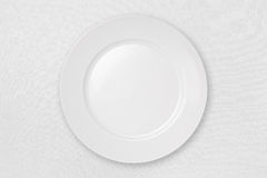 Empty Plate on a White Tablecloth (with clipping p. Empty Plate (with clipping path) isolated on a White Tablecloth royalty free stock images