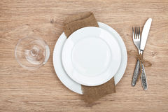 Empty plate, wine glass and silverware set Stock Photo