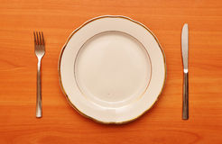 Empty Plate With Fork Knife Stock Image
