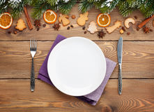 Empty Plate With Silverware Over Christmas Wooden Background
