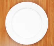 Empty plate on wood royalty free stock image