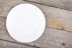 Empty plate on wood table Royalty Free Stock Image