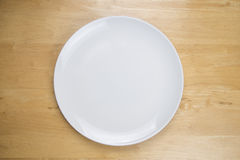 Empty plate on wooden tabel. Empty plate on a wooden tabel Royalty Free Stock Photo