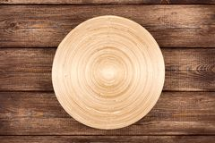 Empty plate on a wooden table Stock Photos
