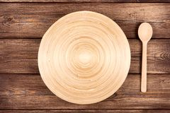 Empty plate on a wooden table Stock Image