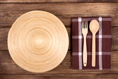 Empty plate on a wooden table Royalty Free Stock Photos