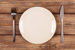 Empty plate on a wooden table Royalty Free Stock Images