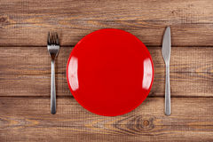 Empty plate on a wooden table Stock Photo