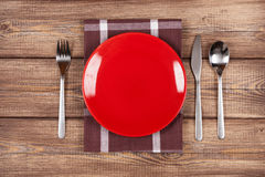 Empty plate on a wooden table Stock Photography