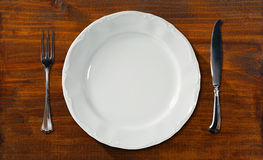 Empty Plate on Wooden Table with Cutlery Royalty Free Stock Image