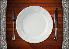 Empty Plate on Wooden Table with Cutlery Stock Photo