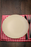 Empty plate on wooden table Stock Images