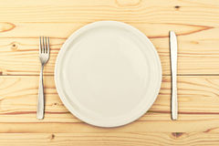 Empty plate on wooden table Royalty Free Stock Images