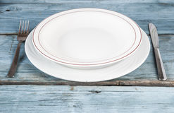 Empty plate on wooden table Stock Photography