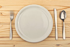 Empty plate on wooden table Stock Image