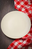 Empty plate on wooden table Royalty Free Stock Photos