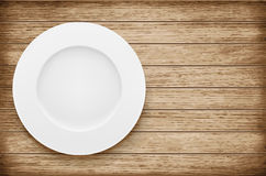 Empty plate on wooden table. Vector illustration Royalty Free Stock Photo