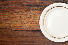 Empty plate on a wooden table. Stock Photography