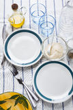 Empty plates with a blue border. serve a table. olive oil . spic Stock Photo
