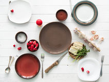 Empty plates with culterly and radish, cheese and garlic Royalty Free Stock Photo