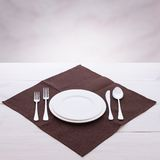 Empty plates and cutlery tablecloth on wooden Stock Photo