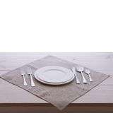 Empty plates and cutlery tablecloth on wooden Royalty Free Stock Images