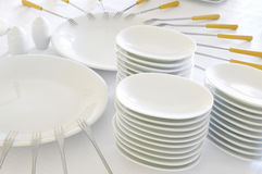 Empty plates with forks Royalty Free Stock Photos