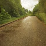 Empty platform. In the countryside, surrounded by green trees Royalty Free Stock Photos