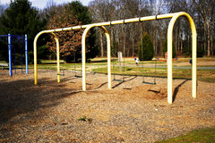 Empty playground. An empty playground with swings Royalty Free Stock Photo