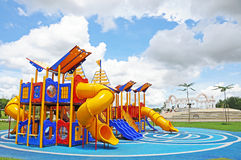 Empty playground. Colorful children playground with blue rubber safety mat, in recreational park area Royalty Free Stock Photography