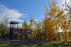 Empty playground at autumn, colorfuly leaves, sunny blue sky. Empty playground at autumn, colorfuly leaves, blue sky Royalty Free Stock Photo