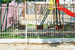 An empty Playground with bright slides and swings on Sunny day. royalty free stock photo