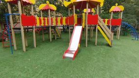 Empty playground in city park. stock video footage