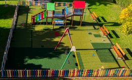 Empty playground sunny day. Empty playground on sunny day panoramic view Royalty Free Stock Image