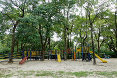 Empty playground surround by trees Royalty Free Stock Image