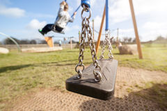 Empty playground swing Royalty Free Stock Images