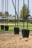 Empty playground swings. Empty swings in a school yard playground Stock Photography