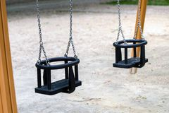 Empty playground swings Royalty Free Stock Image