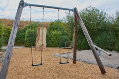 Two swings on a playground in Germany stock photo