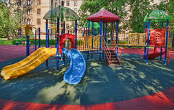 Empty Playground in the yard. In summer Stock Image
