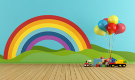 Empty Playroom with rainbow and toys. Empty Playroom with toys, rainbow,green hills, sun and clouds on the wall- rendering Royalty Free Stock Image