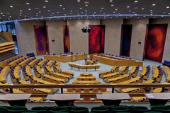 Empty plenary hall of the House of Representatives seen from the public stand where the journalists and general public remain stock images