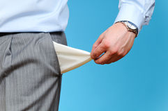 Empty Pocket. Man Pulling out Empty Pocket, on blue background Stock Photos