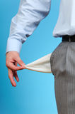 Empty Pocket. Man Pulling out Empty Pocket, on blue background Royalty Free Stock Images