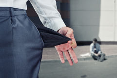Empty pocket - bankruptcy. Businessman pulling empty pocket out of pants Stock Photography