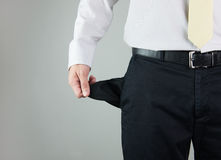Empty pocket. Close-up of a man showing empty pocket Royalty Free Stock Photo