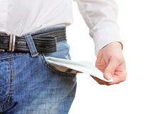 Empty Pocket Closeup. Man in Jeans shows his Empty Pocket Closeup Isolated on the White Background Royalty Free Stock Image